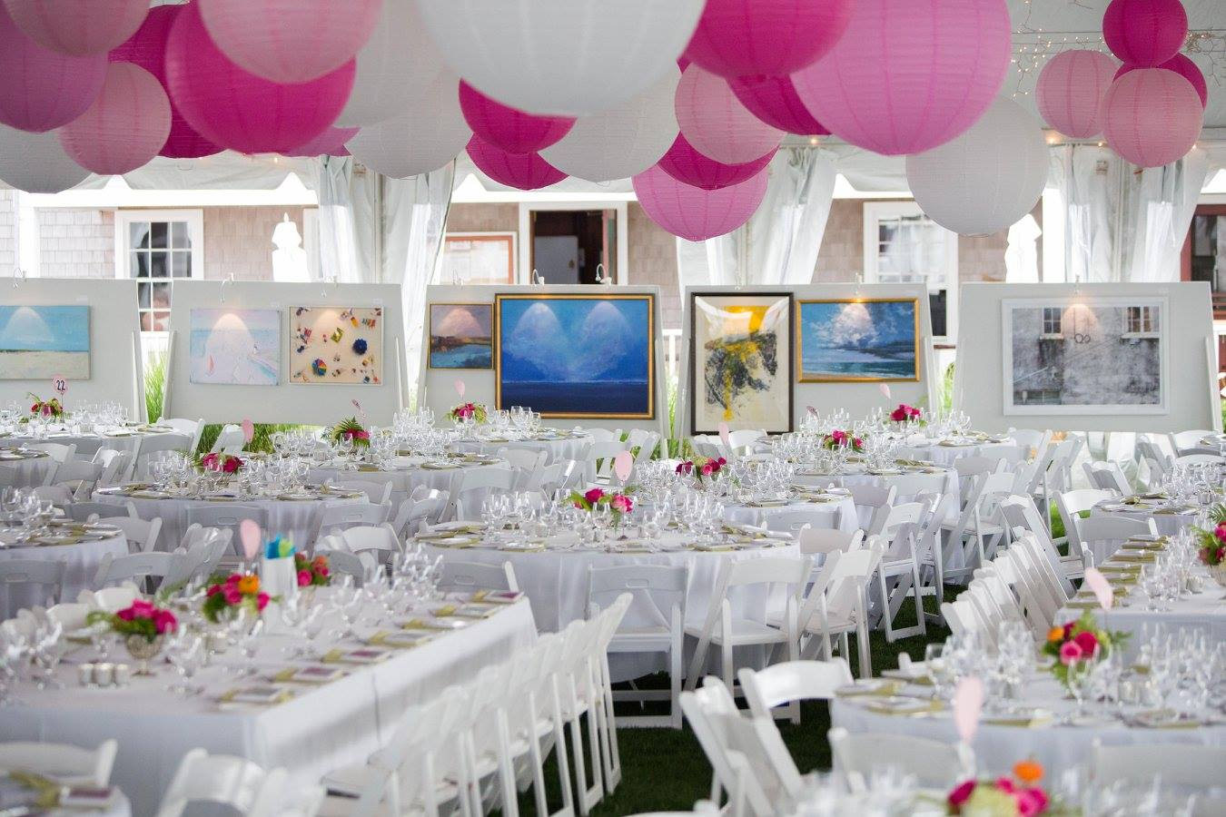 Event With Beautiful Place Settings at Tables and Artwork Displayed