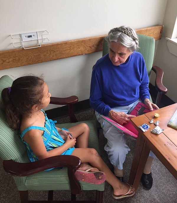 Old woman talks to little girl